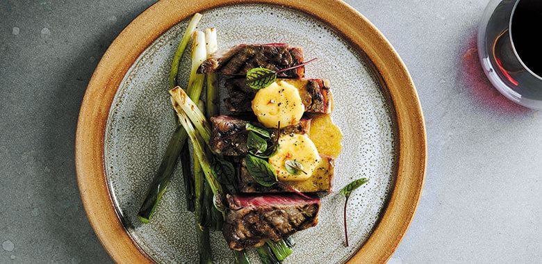 CHARCOAL GRILLED GRASS FED BEEF SIRLOIN WITH SPRING ONIONS AND MISO BUTTER