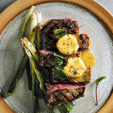 CHARCOAL GRILLED GRASS FED BEEF SIRLOIN WITH SPRING ONIONS AND MISO BUTTER THUMB