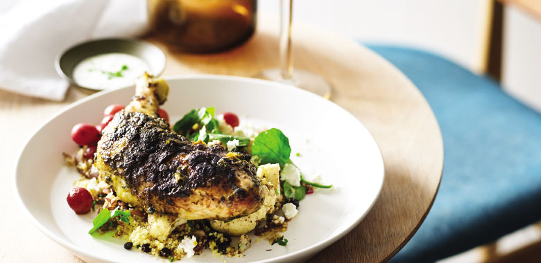 Chermoula-roasted chicken with cauliflower couscous, roasted grapes & minted yoghurt