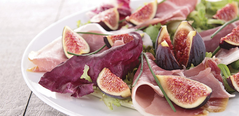 Fresh Figs with blue cheese and proscuitto paired to medium red wine