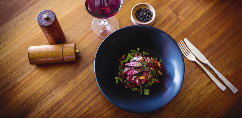 Neale White's pan-roasted Blackmore's wagyu beef skirt salad with pomegranate, macadamia and herb red slaw