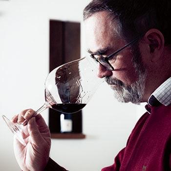 Tim Kirk tasting red wine at Clonakilla vineyard